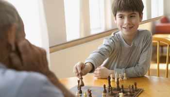 Kid playing chess.