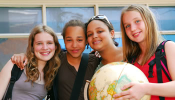 Students with a globe.